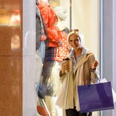 Woman shopping bags enjoy evening city
