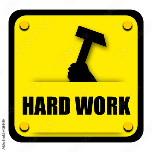 Hard work sign with heavy hammer