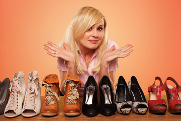 Beautiful Blonde making a deccision about shoes