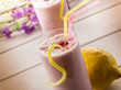 raspberry  milkshake on glass with straw