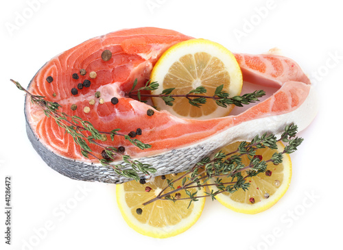 Red fish with lemon and thyme isolated on white.