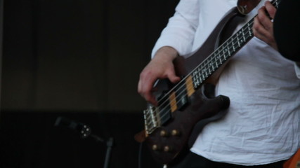 Bassist plays at a live concert