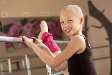 Child Ballerina Stretching Her Leg