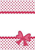 Red and white polka dot gift bow and ribbon borders on white