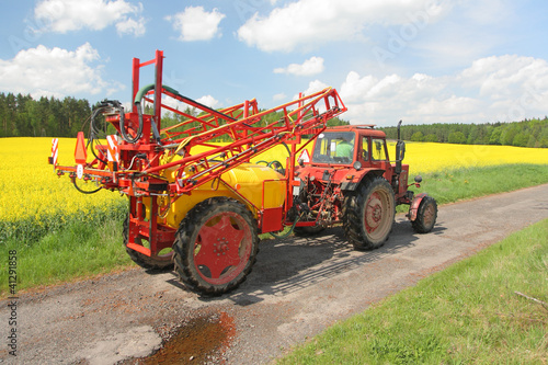 Tractor with a spraying instalation