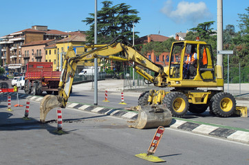 roadworks with a scraper to work in the middle of the road
