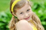 Face of Pretty Little Girl in Yellow