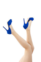 Sexy long legs in blue high heels shoes
