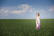 beautiful woman on green field in dress
