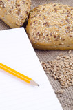 multigrain roll and a booklet for notes poster