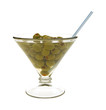 Olives in glass with straw