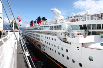 Side view of a cruise ship at Canada Place, Vancouver BC Canada.