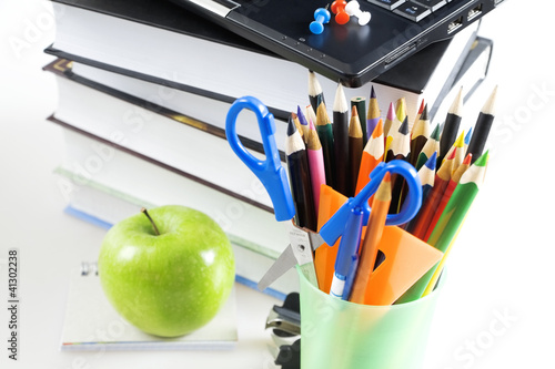 office supply and apple on white background