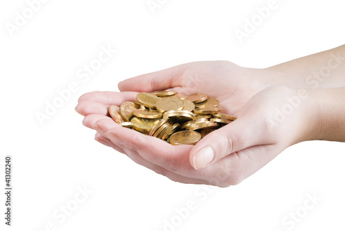 golden coins in woman hands on white background