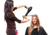 studio shot of hairdresser with hairdryer