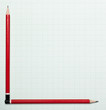 Blank graph paper with pencils as axis
