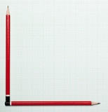 Blank graph paper with pencils as axis poster