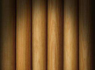 Wooden pole background texture lit dramatically