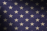 Stars in a field of blue on an American flag lit diagonally