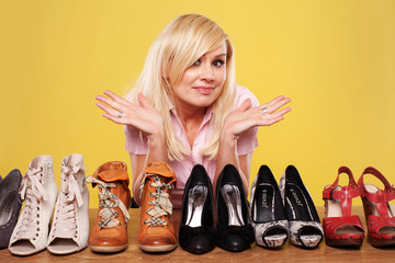 Pretty blonde undecided on which shoes to wear