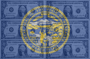 US state of nebraska flag with transparent dollar banknotes in b