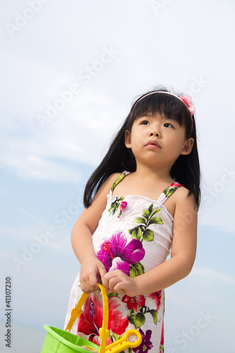 Portrait of little girl on beach