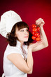 Smiling happy cook woman with red tomato