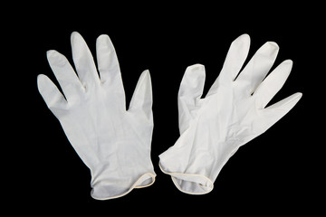 Medical gloves on black background