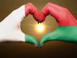 Heart and love gesture by hands colored in madagascar flag durin