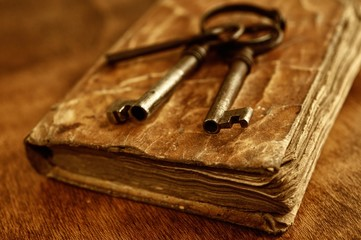 Old metal keys on vintage book.