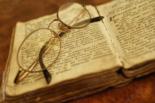 Glasses on vintage book.