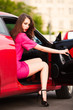 stylish woman in red car