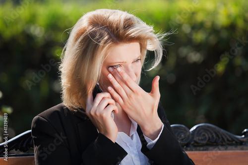 Sad woman calling on the phone