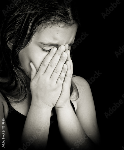 Black and white portrait of a girl crying