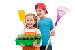 Kids with spring seedlings and gardening tools