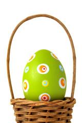 Single Easter egg into a basket