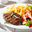 Grilled Steak with French Fries and Salad
