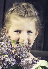 Blonde girl with a bouquet of spring flowers