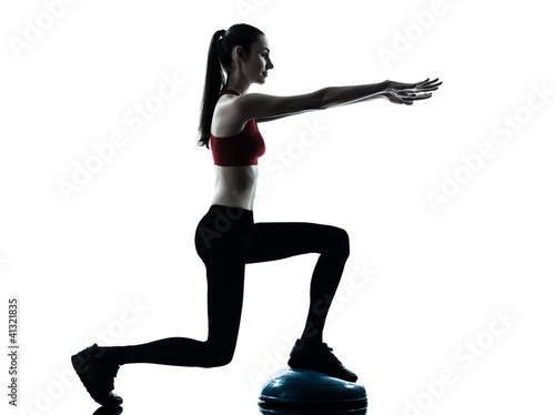 woman exercising bosu balance ball trainer
