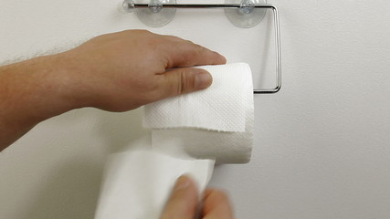 Taking Sheets Of Toilet Paper
