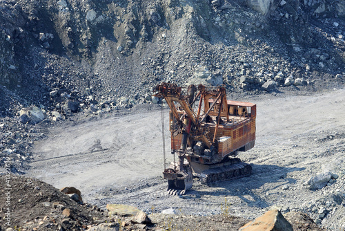 Old rusty excavator in the asbestos quarry