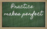 Fototapety expression -  Practice makes perfect - written on a school black