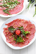 Carpaccio with salad and pine nut