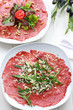 Carpaccio with arugula and cheese