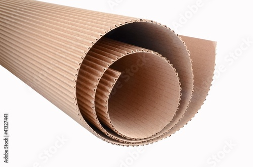 close view on corrugated cardboard rolled up, isolated
