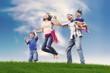 Happy Asian Family in Meadow