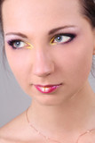 Close-up portrait of beautiful brunette with make up