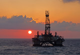 Drilling rig in sunset