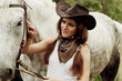 Beautiful cowgirl. Shot in the stable