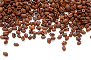 Brown roasted coffee beans isolated on white